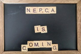 "A chalk board with Scrabble letters spelling out ""NEPCA is coming"" in the center."