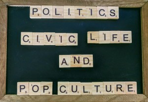 "A small blackboard with scrabble letters on it spelling out ""Politics Civic Live and Pop Culture"""