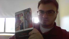 A photo of Anthony G. Cirilla holding up a book (title unclear).