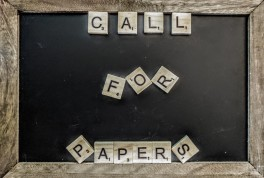 "A chalk board with Scrabble tiles that spell out ""Call for Papers"""