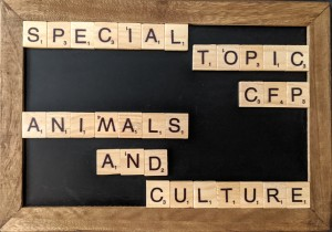"A small chalkboard with Scrabble letters that spell out ""Special Topic CFP - Animals and Culture"""