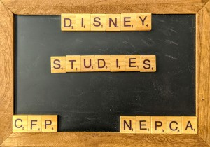 "A chalk board with scrabble tiles that spell out ""Disney Studies CFP NEPCA"""