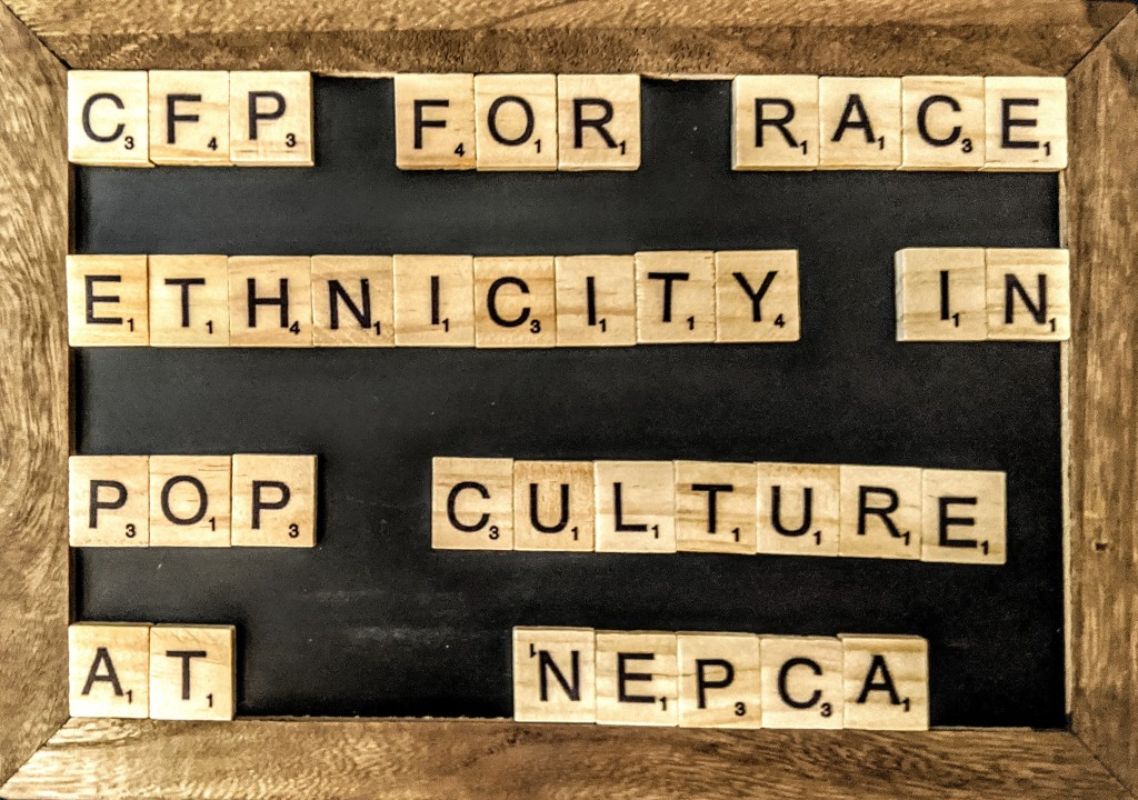 """A Chalkboard with scrabble letters on it that spell out """"CFP for Race and Ethnicity in Pop Culture at NEPCA"""""""
